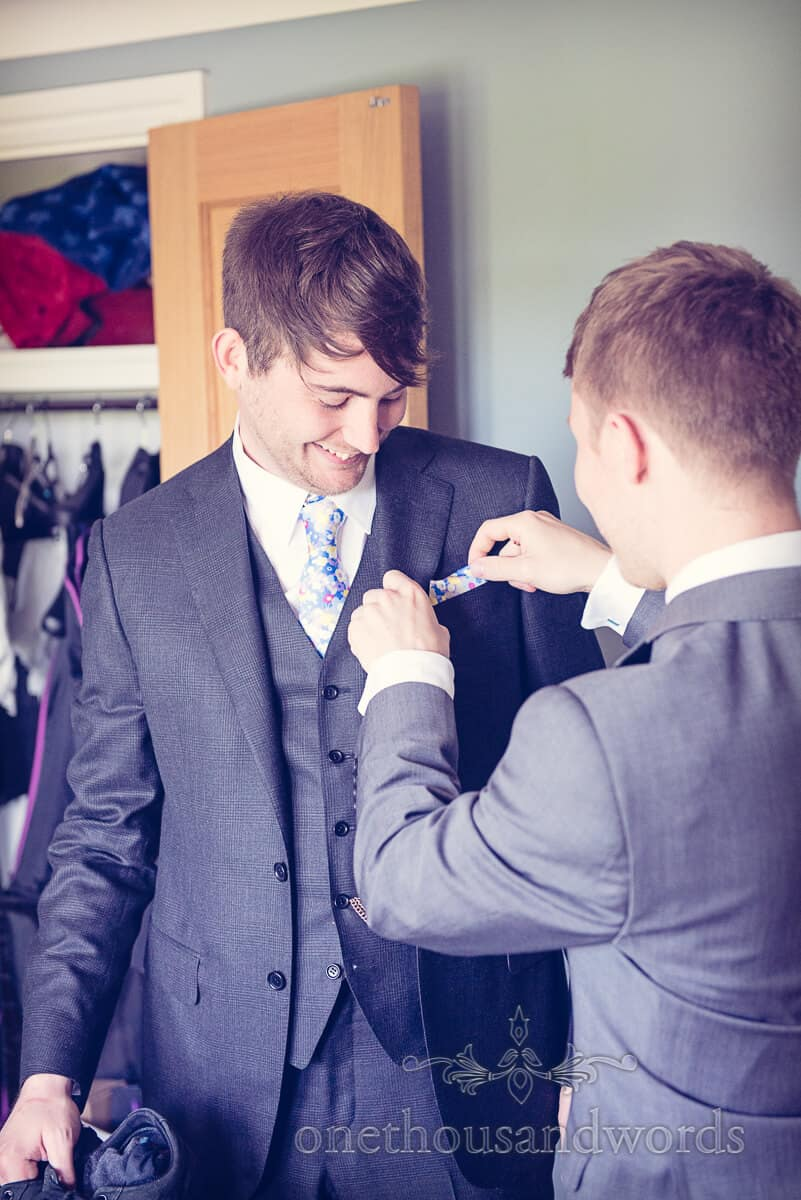 Groom with designer floral wedding tie