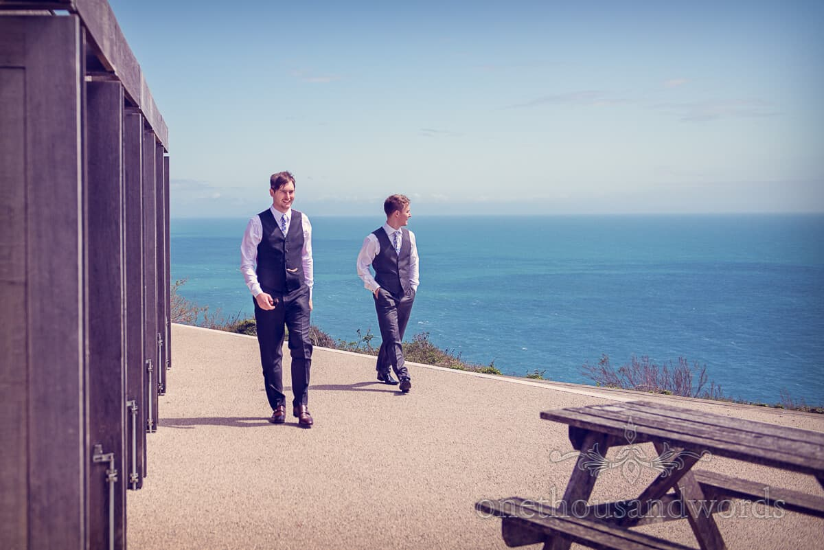 groom by the sea in Swanage wedding photographs
