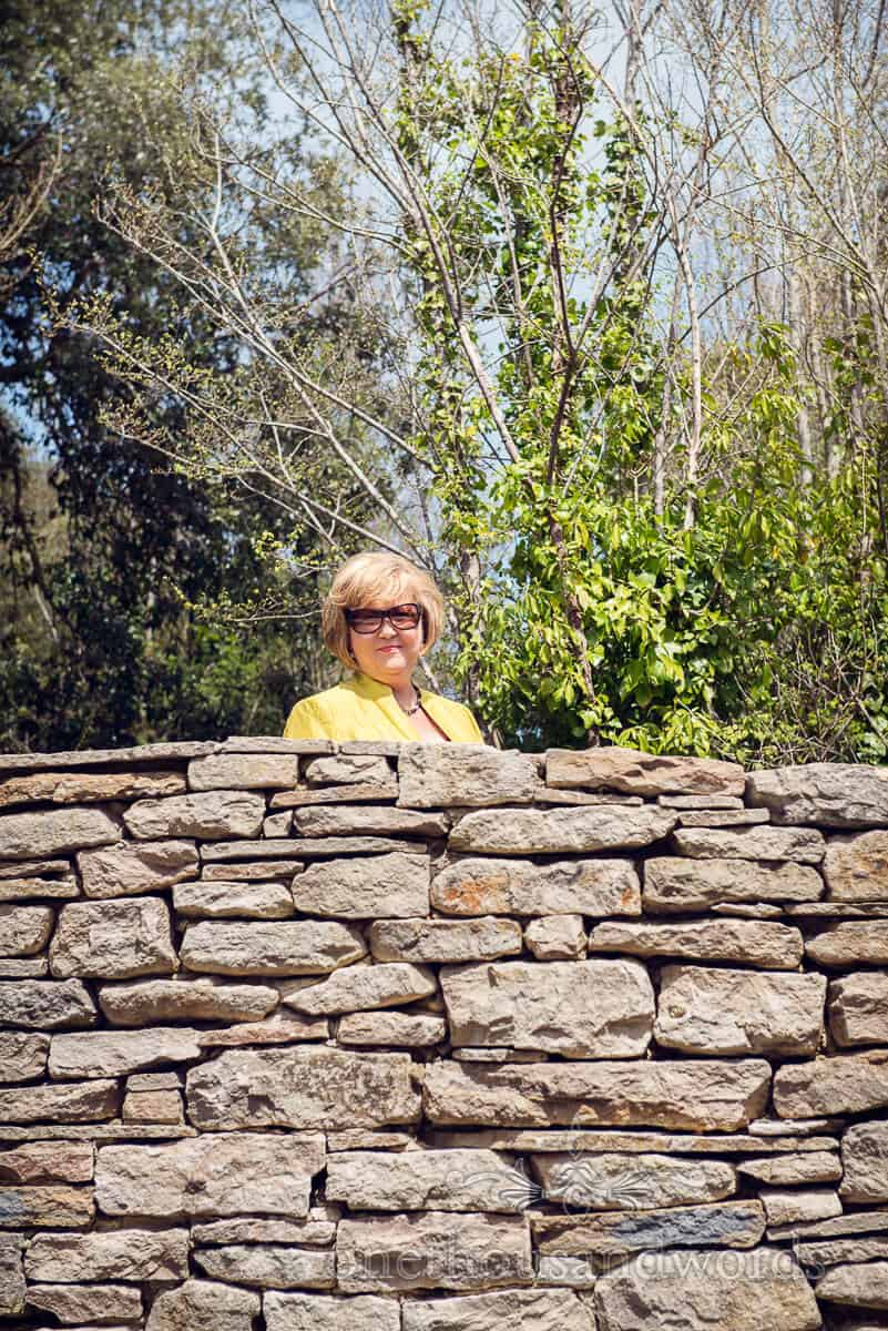 wedding guest with Purbeck stone wall