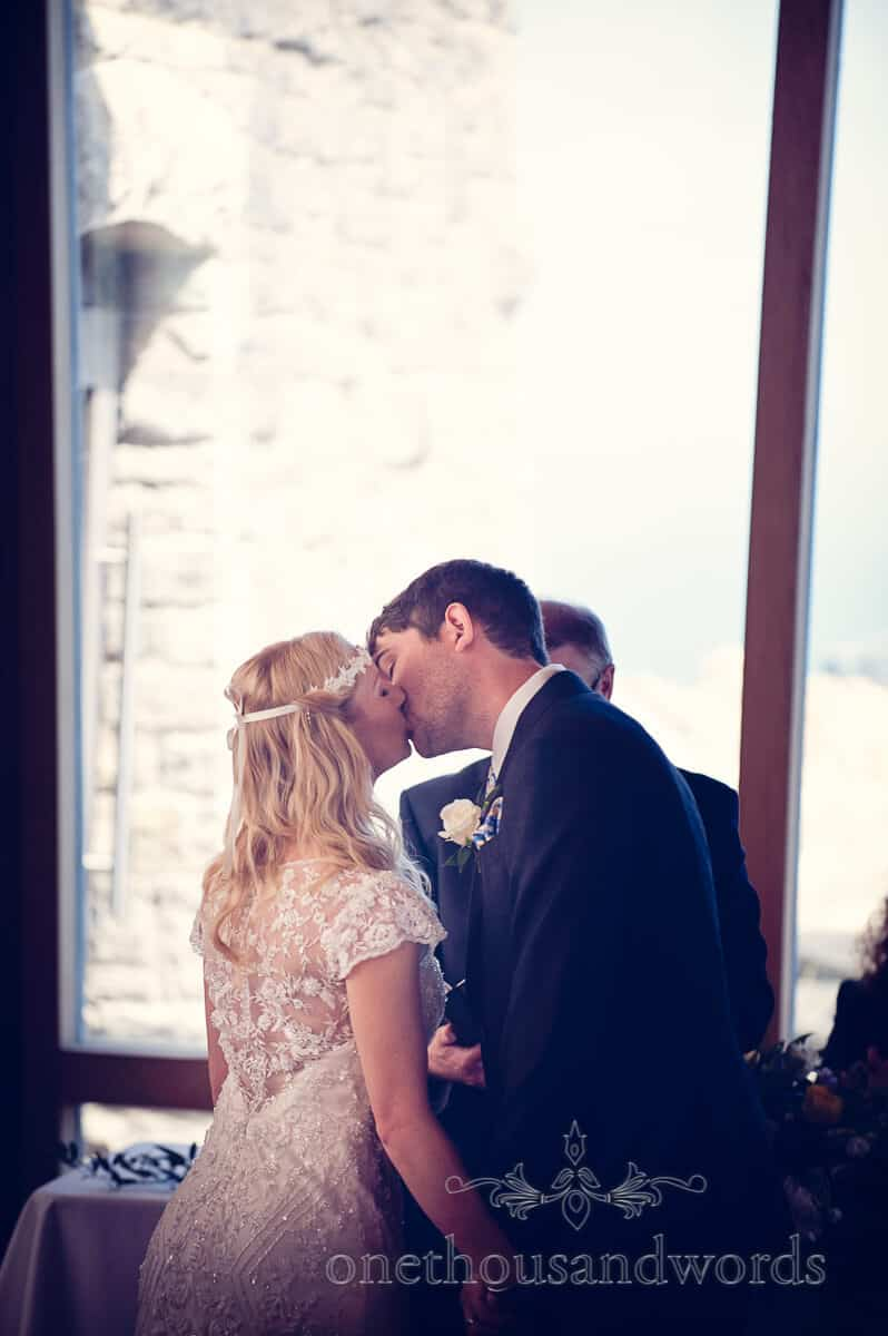 bride and groom kiss at Swanage wedding ceremony