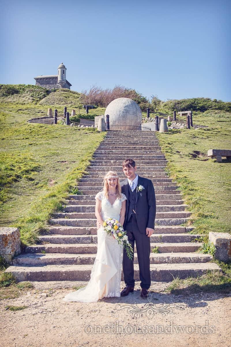 Wedding couple with Durlston Castle Stone Globe
