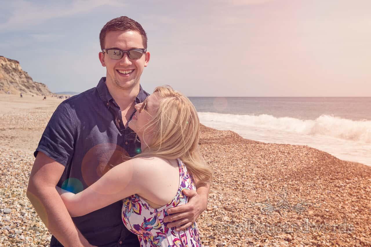 Engagement portrait photograph on beach