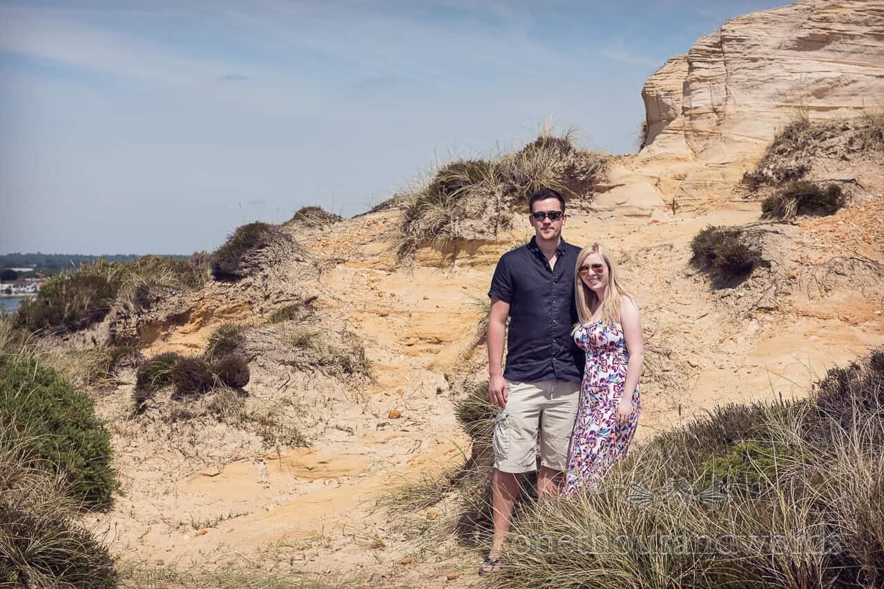 Engagement couple in sand dunes at Hengistbury Head