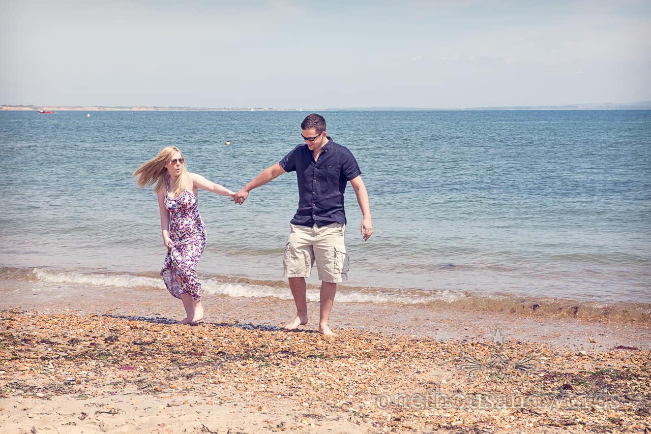 Engagement couple in the sea at Hengistbury Head