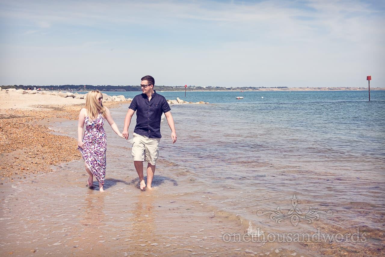 hengistbury head photographs couple on beach in sea