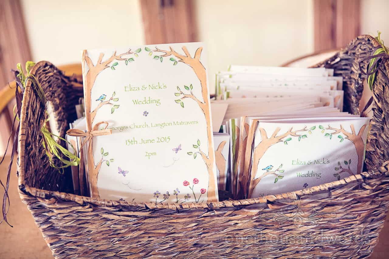 Country wedding photographs invites in wicker basket