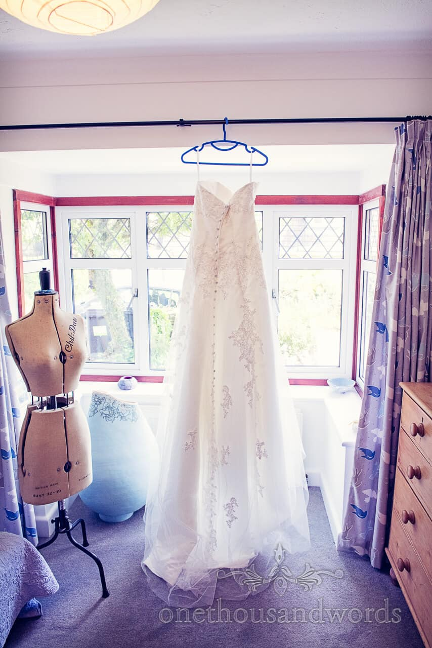 Stunning ivory detailed wedding dress photograph