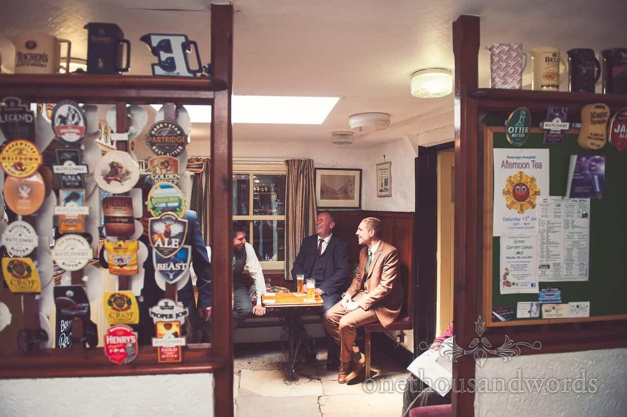 Groom and groomsmen in pub on wedding morning
