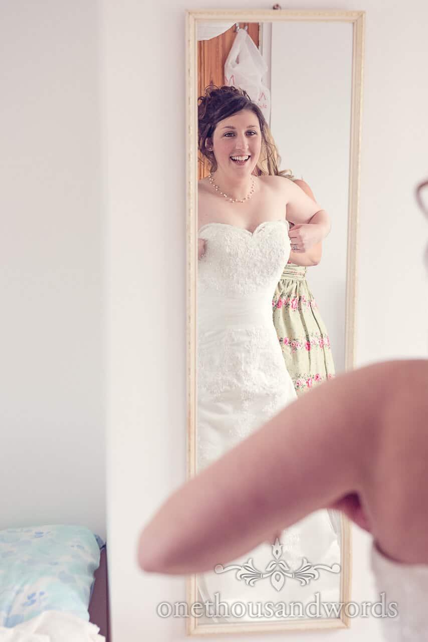 Documentary wedding photograph of bride in mirror
