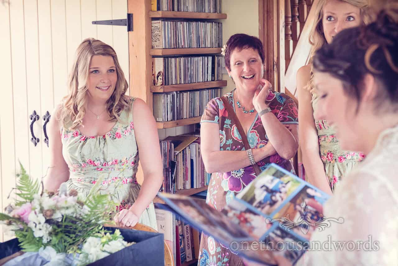 bride with photo book gift on wedding morning