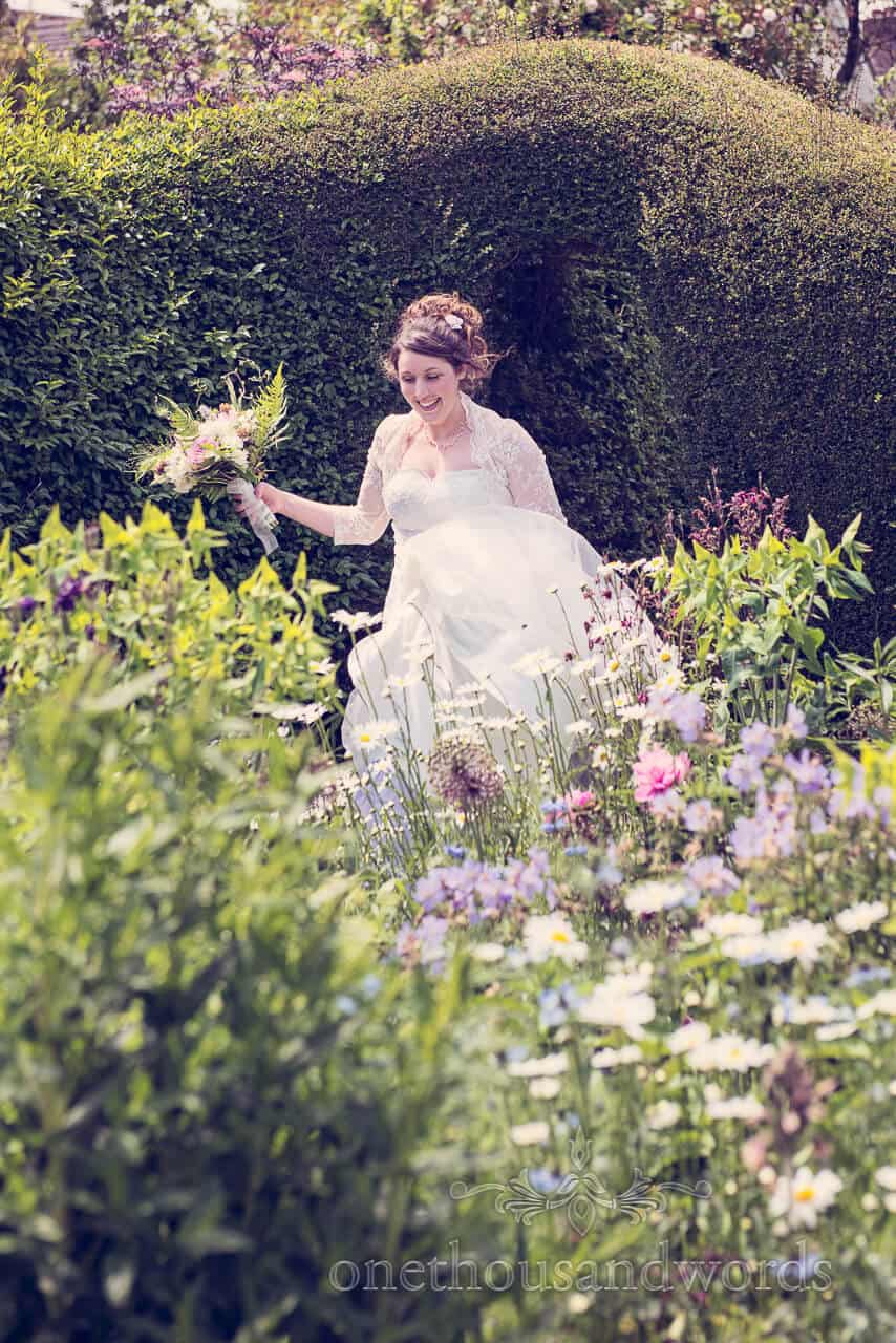 country wedding photographs of bride in flower garden