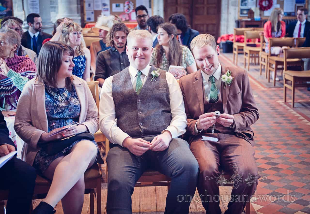 Best man portrait with groom looking at pocket watch