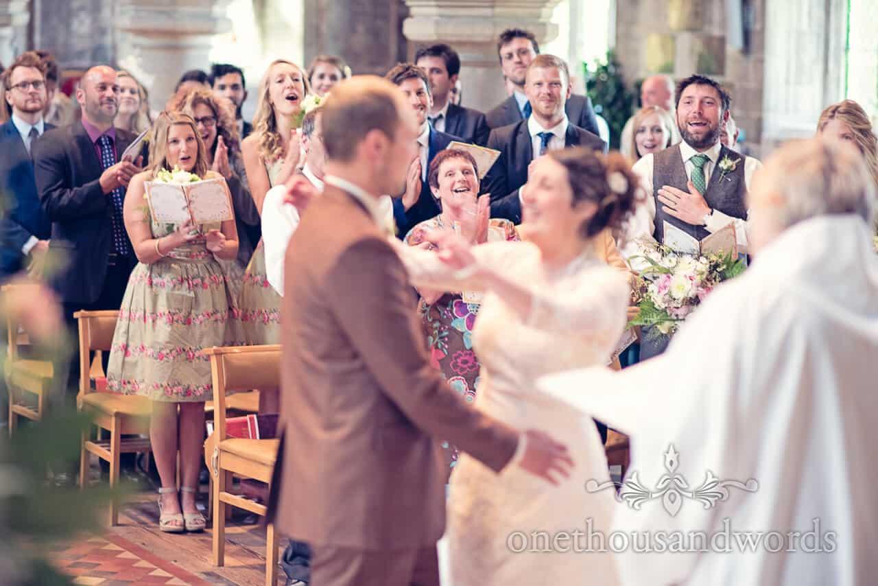 Guests applaud bride and groom wedding service