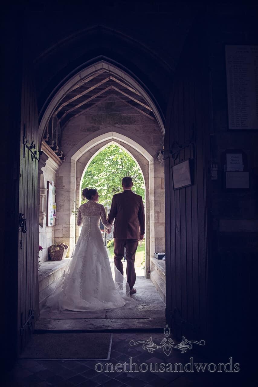 Bride and groom in church doorway in Langton Matravers