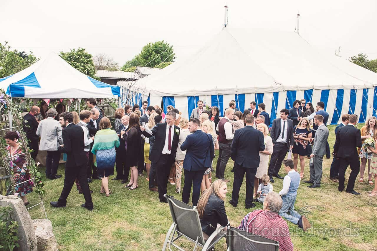 country wedding photographs marquee with blue candy stripes