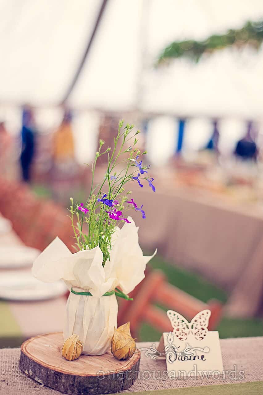 country wedding table flowers and butterfly name place
