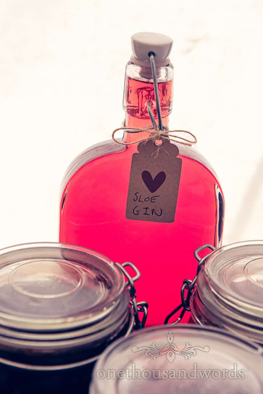 Home made sloe gin bottle at countryside wedding