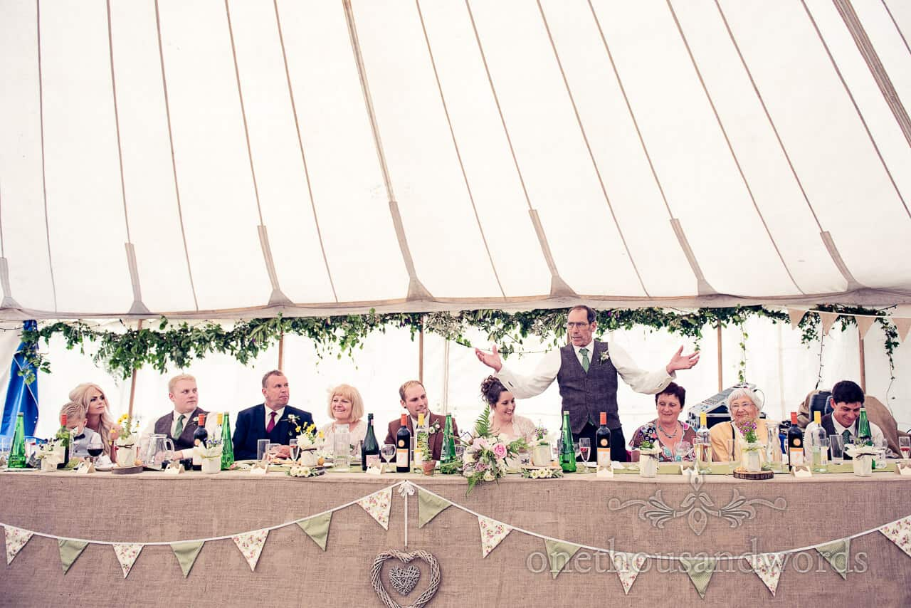Country wedding photographs of wedding speeches