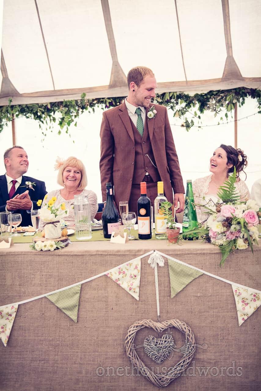 Country wedding photographs of groom's speech
