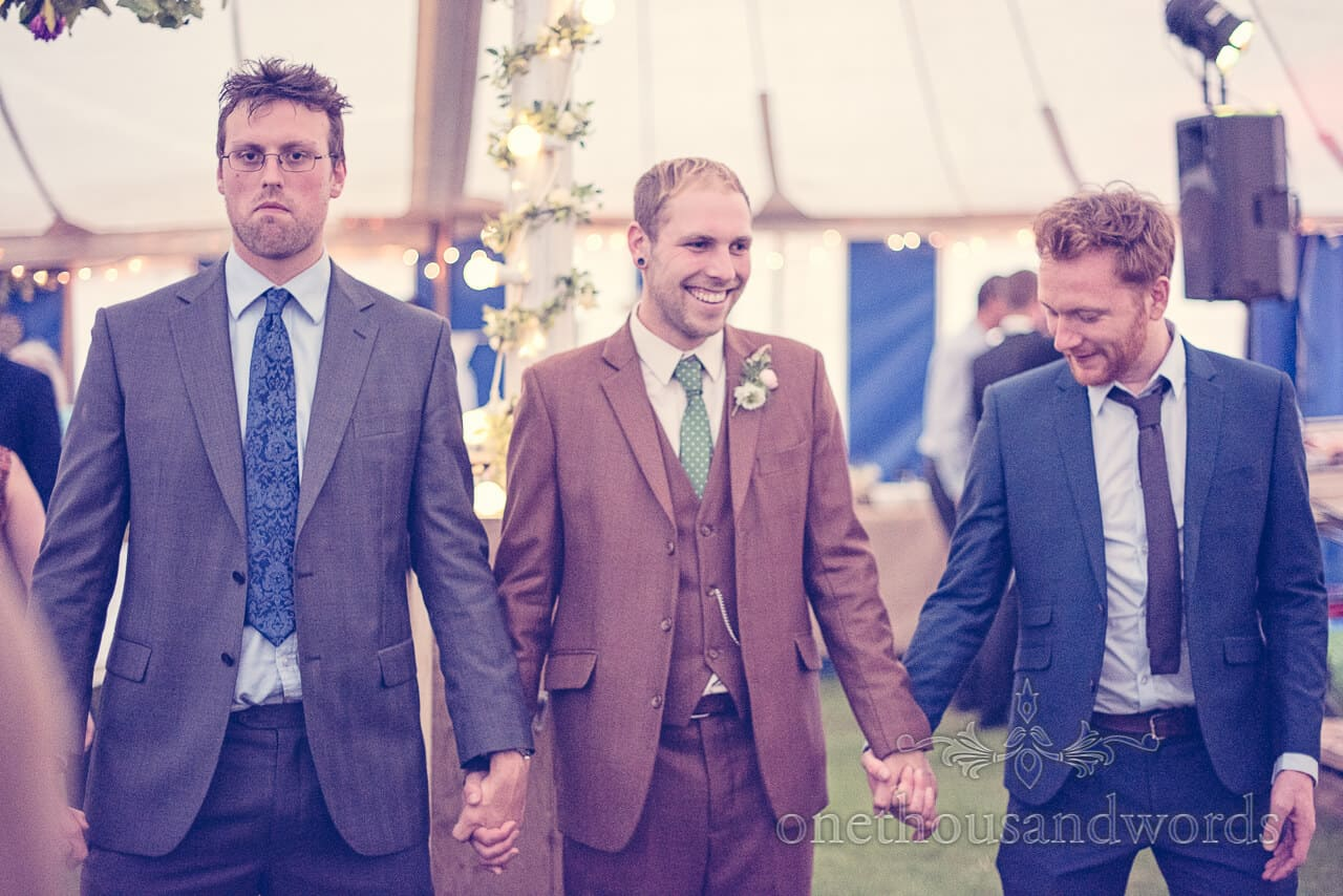 country wedding photographs of Groom at wedding barn dance