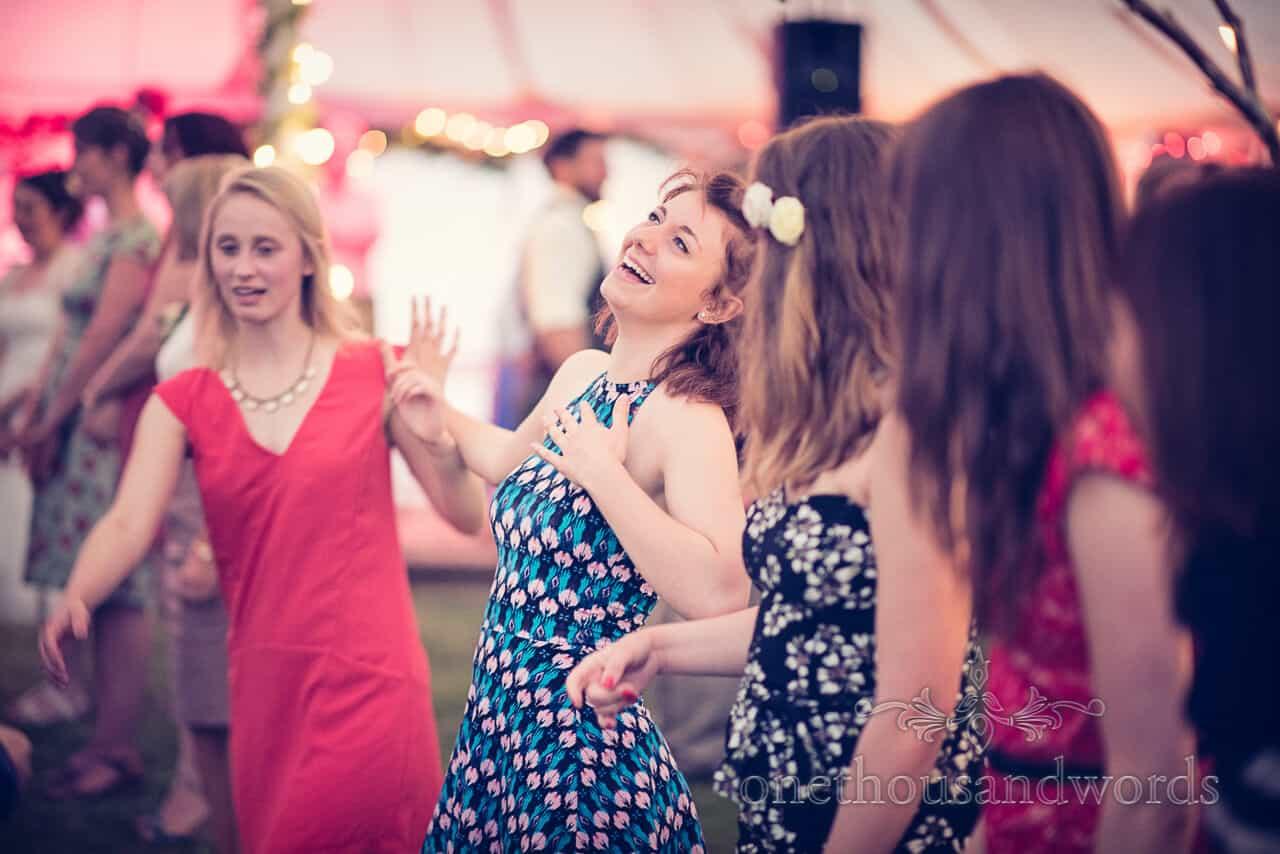 Gorgeous wedding guests barn dancing