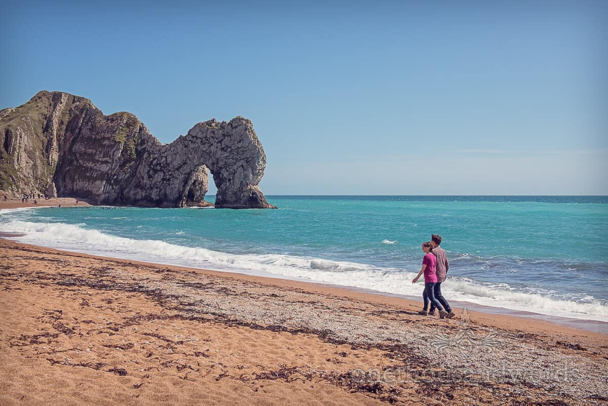 Durdledoor engagement photographs-Walking towards the arch