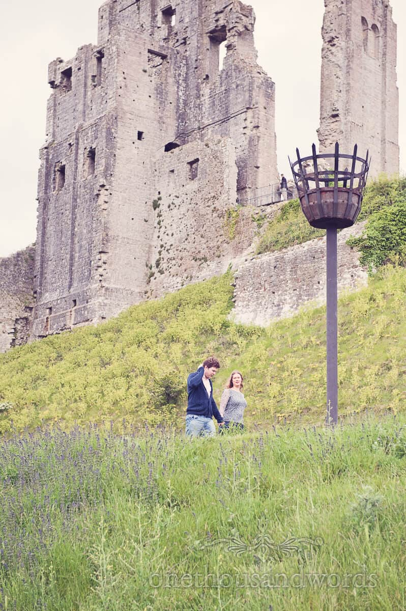 Bride and groom to be at Corfe Castle in Dorset