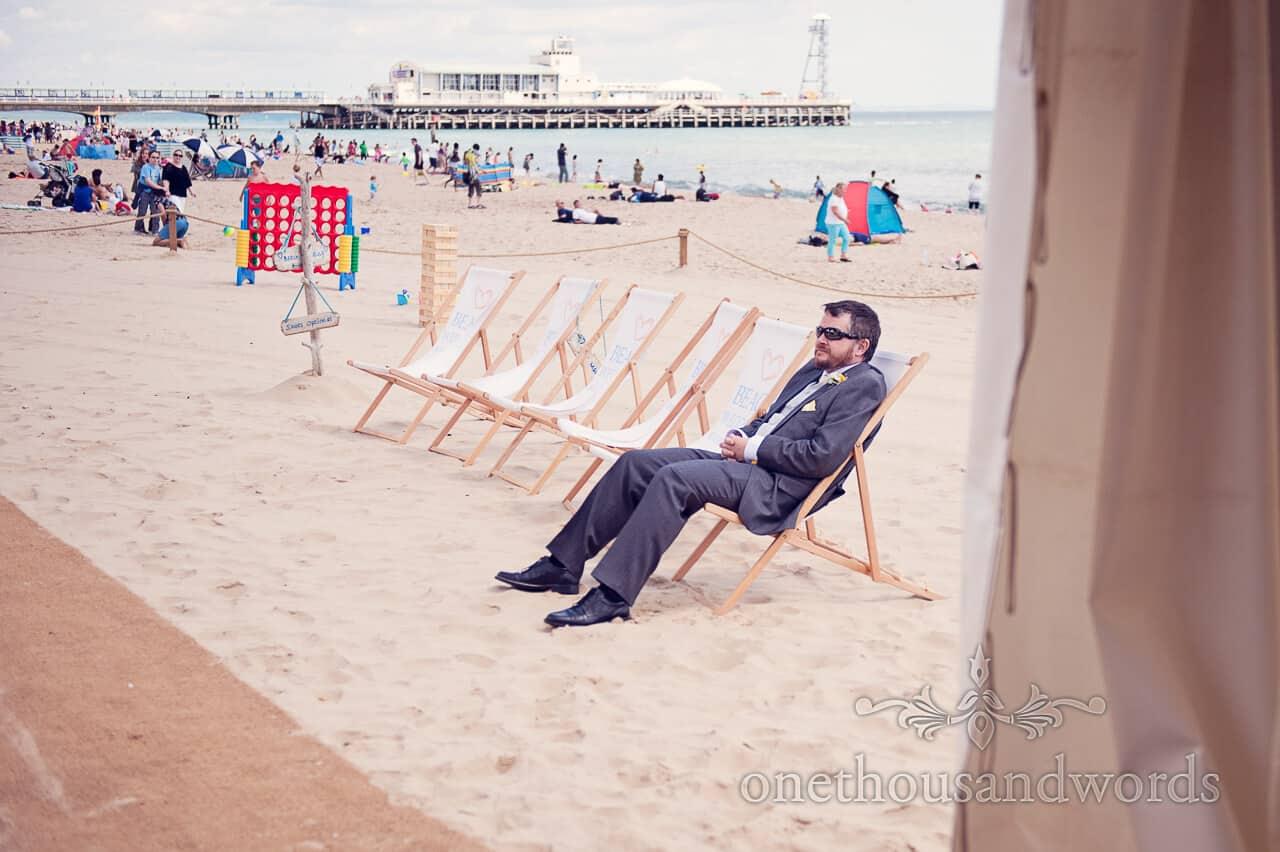 best man in deck chair on Bournemouth Beach