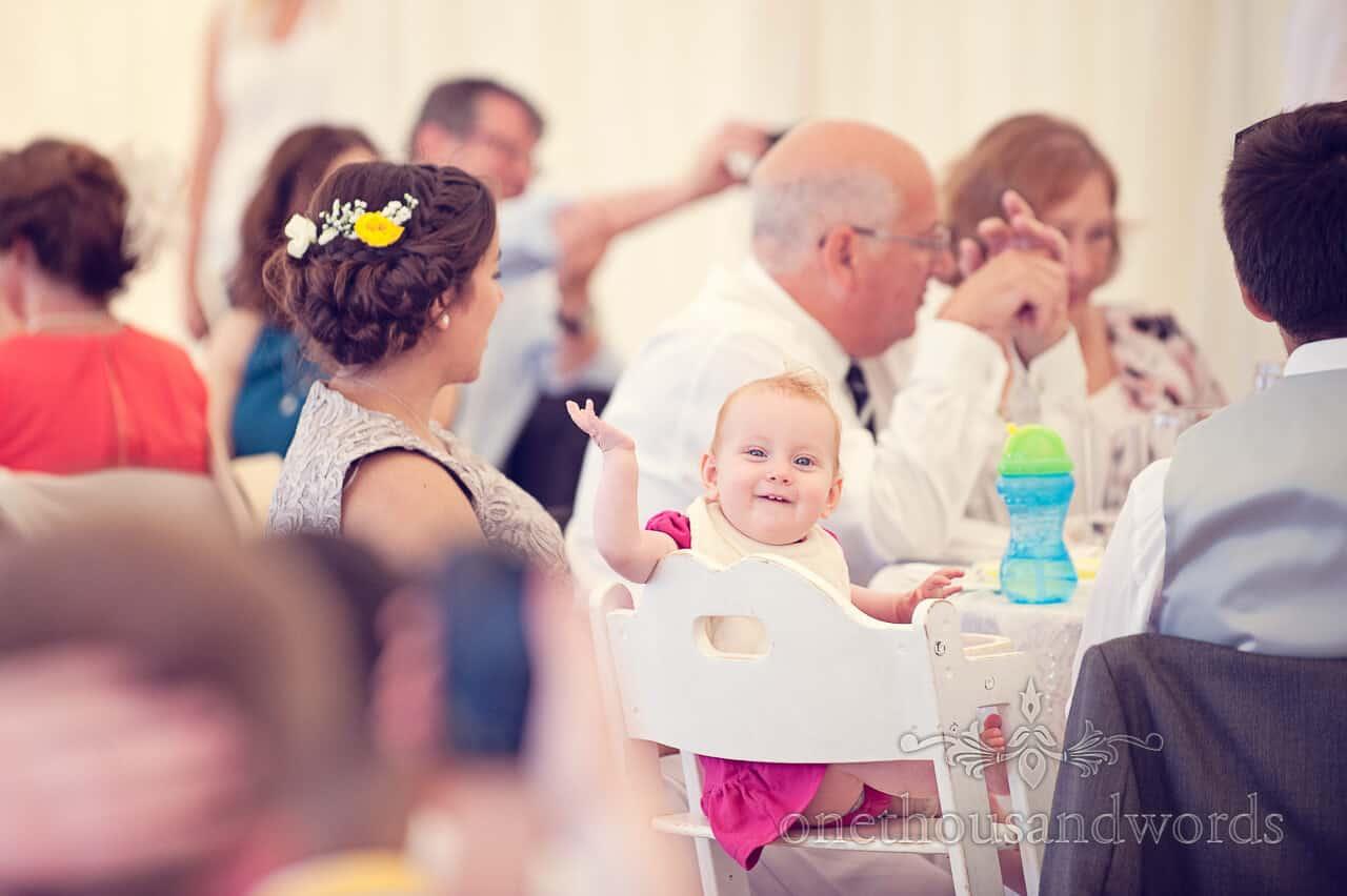 baby at Beach wedding Bournemouth wedding breakfast