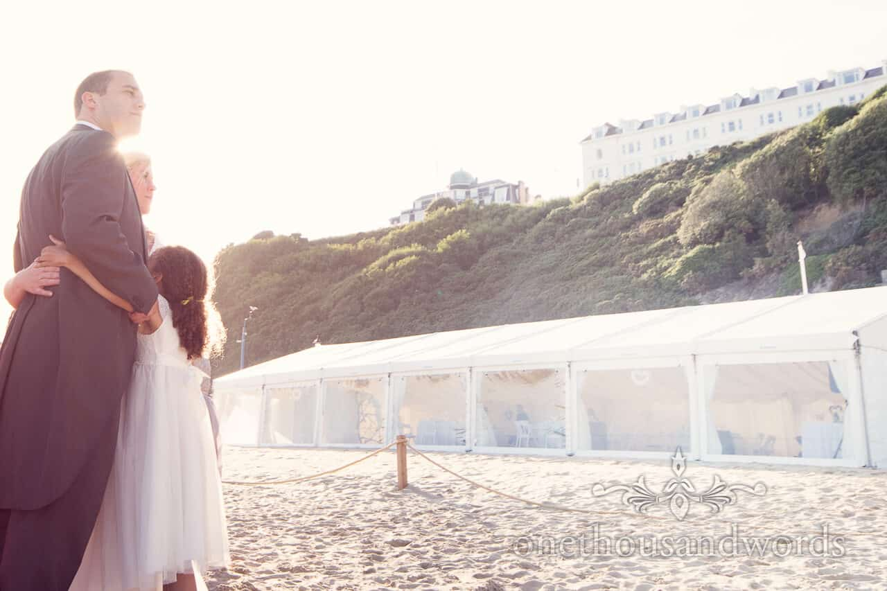 bride and groom hug at Bournemouth Beach wedding