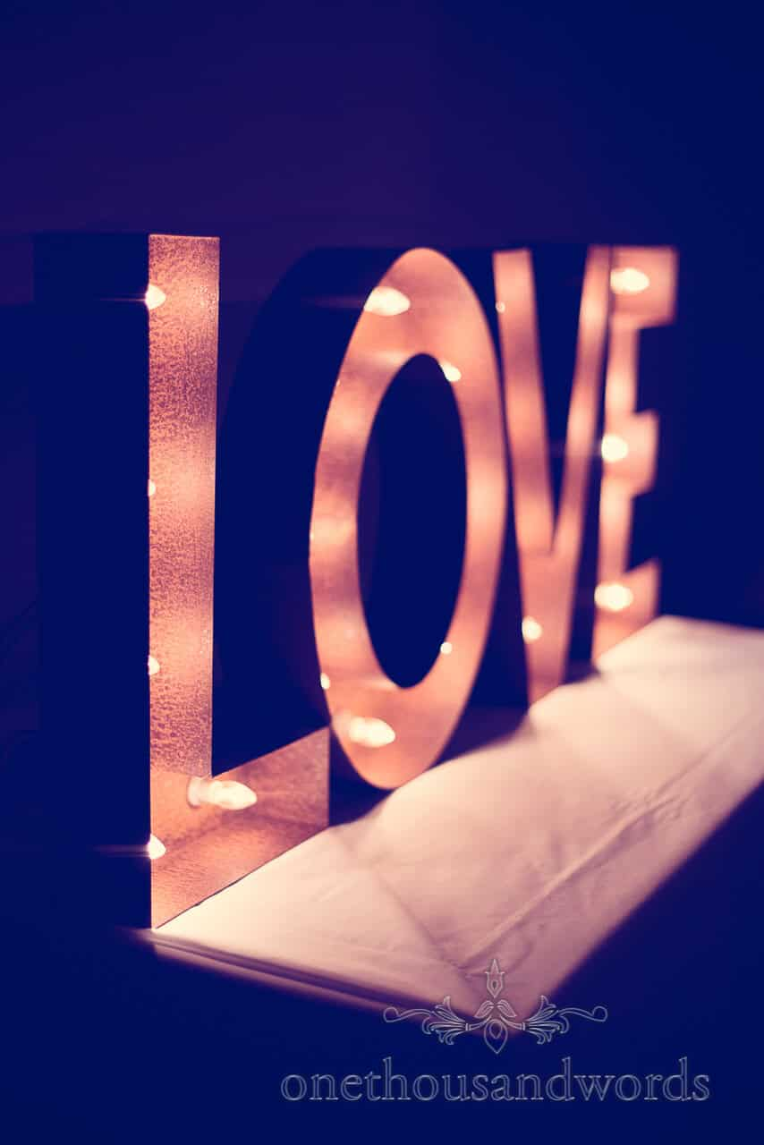 rusty metal wedding love sign with light bulbs