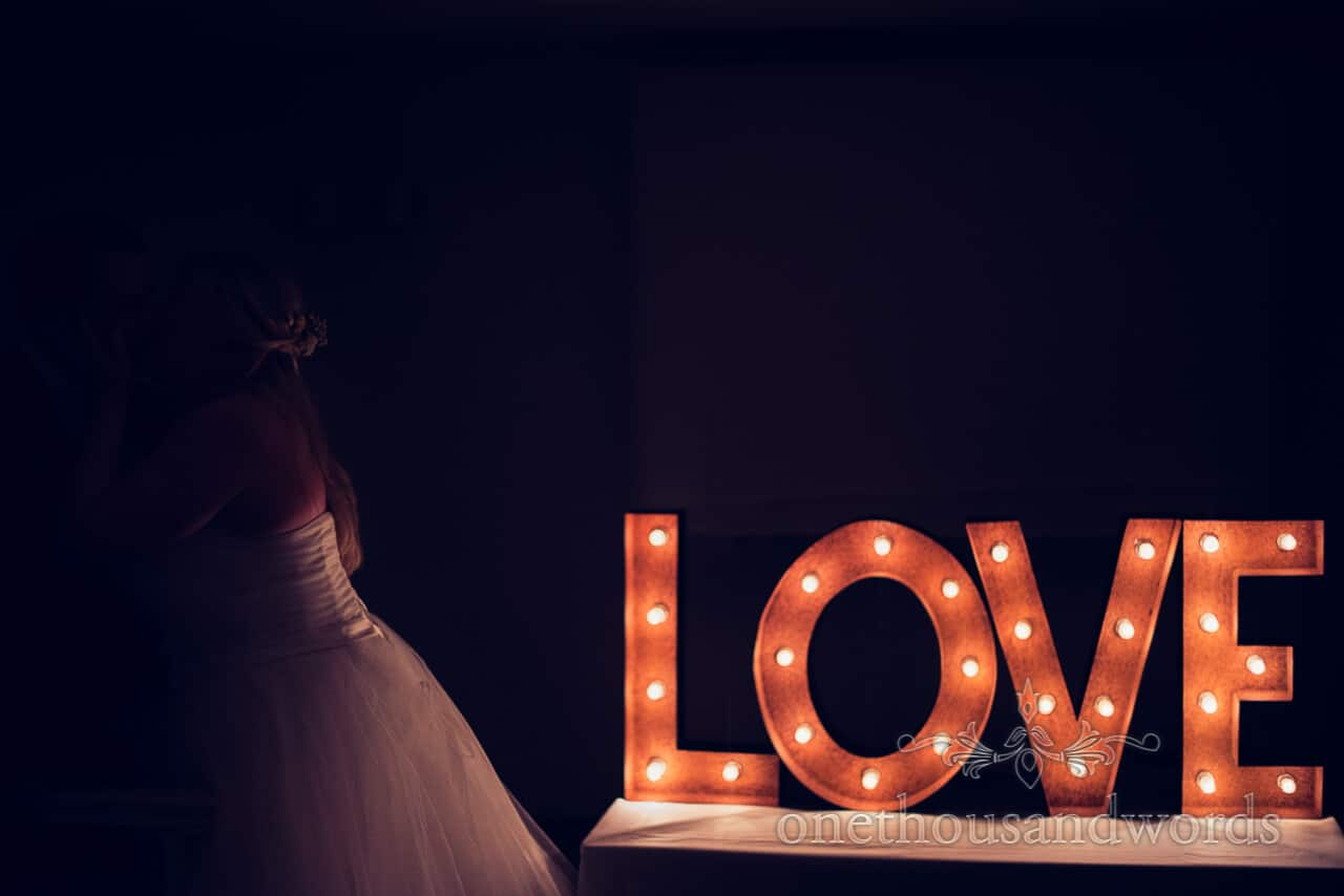 wedding love sign with bride and groom kissing