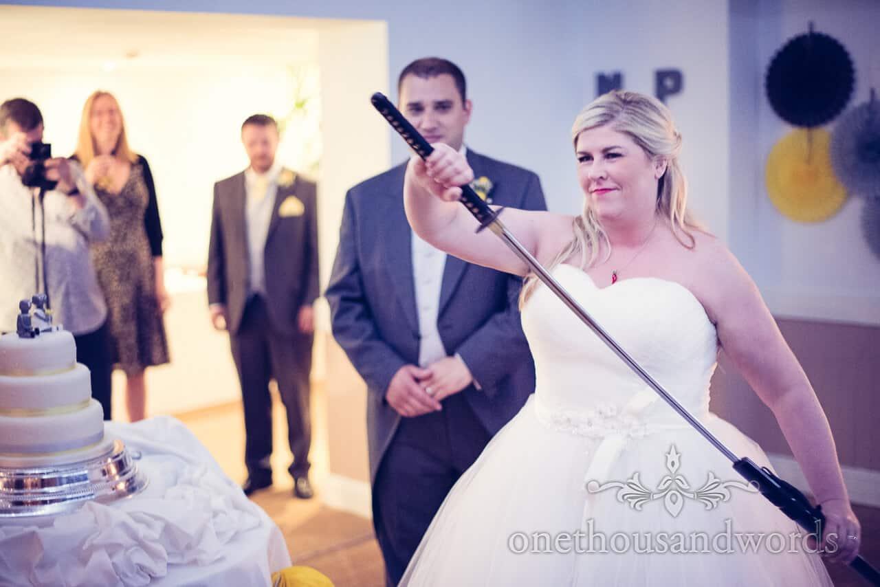Cutting wedding cake with Samurai Sword