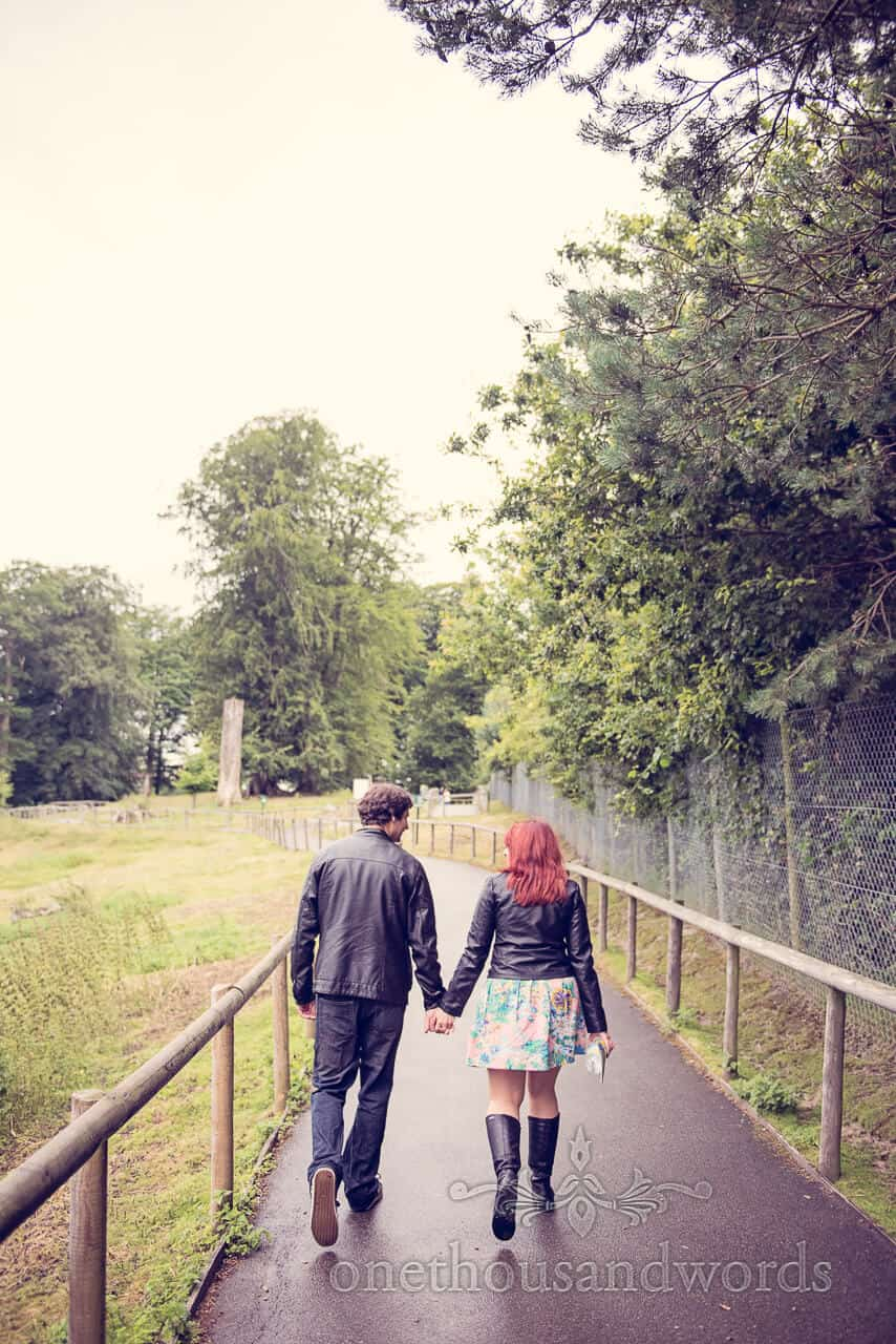 Couple walking hand in hand at Longleat