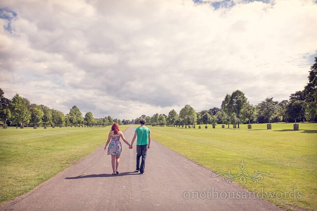 Engaged couple walk through Longleat grounds