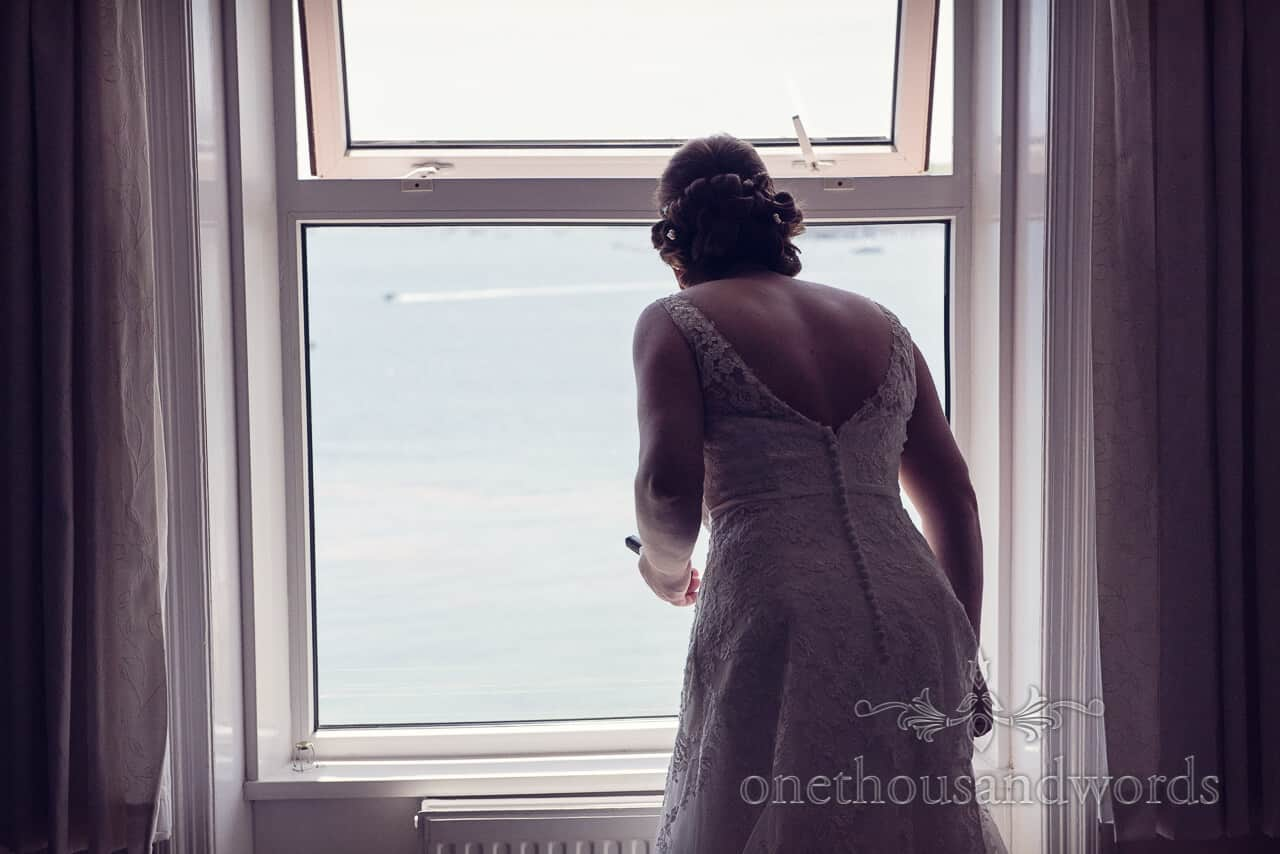 bride looks at sea at Grand Hotel Swanage wedding