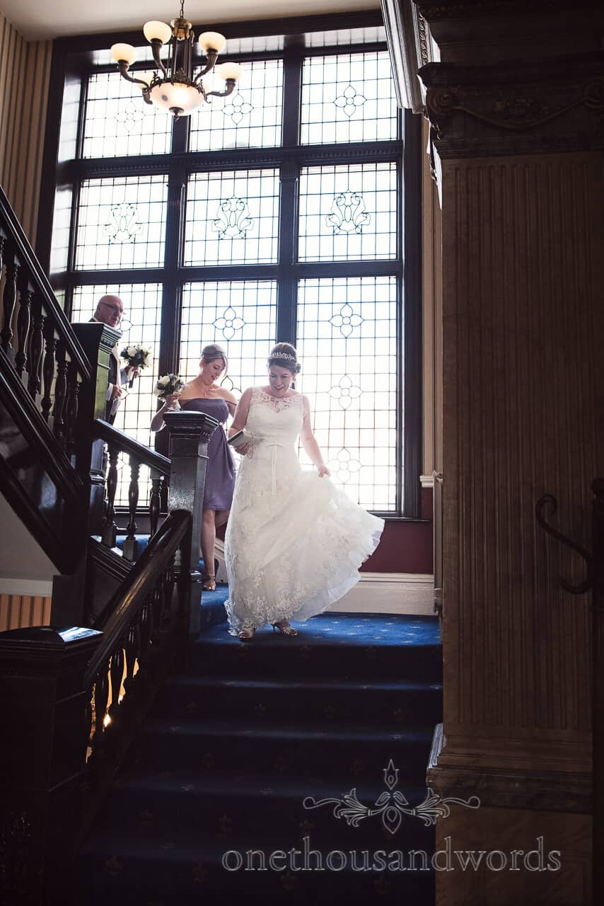 Bride on wooden staircase at Grand Hotel Swanage wedding