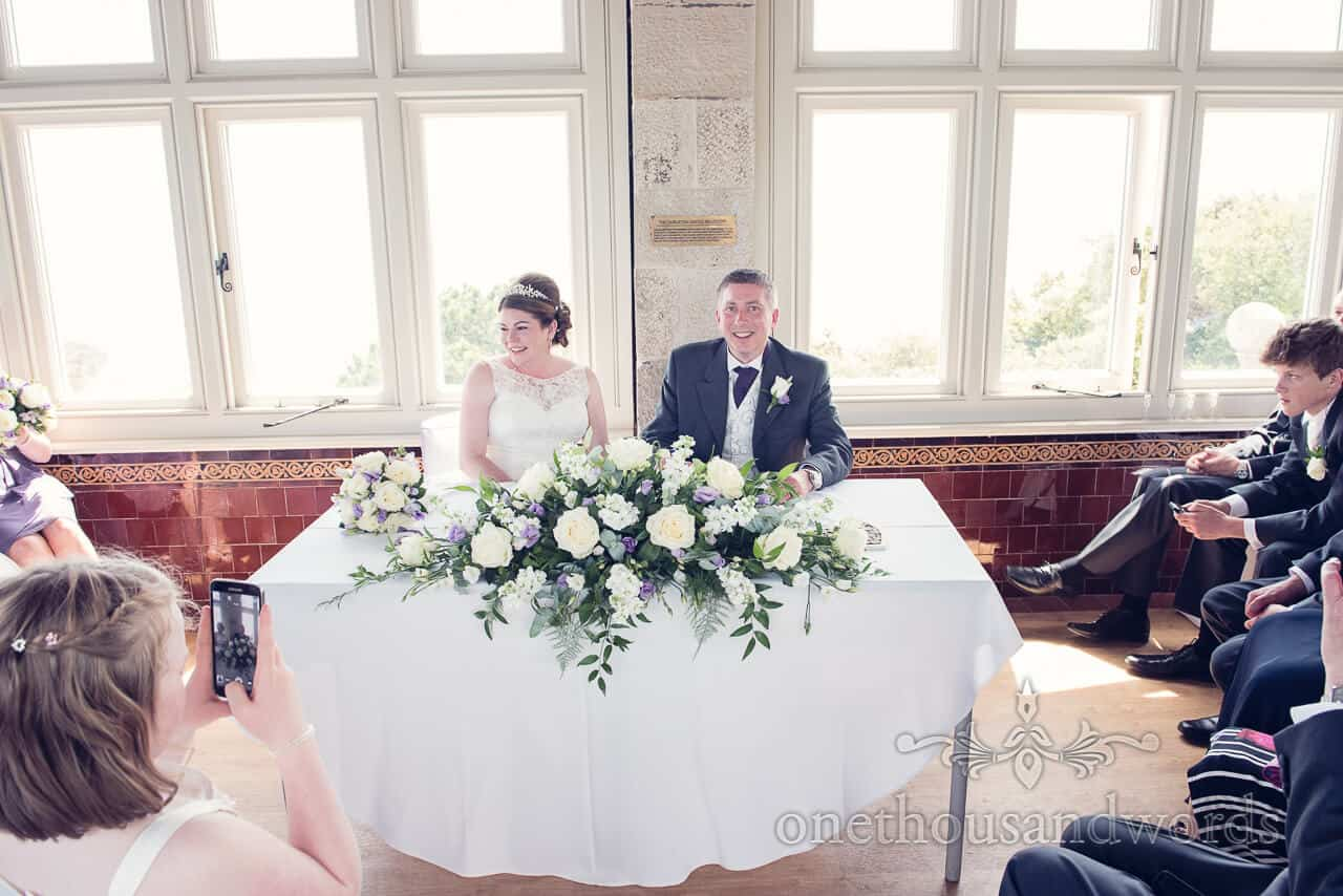 Signing the register at Durlston Castle Wedding