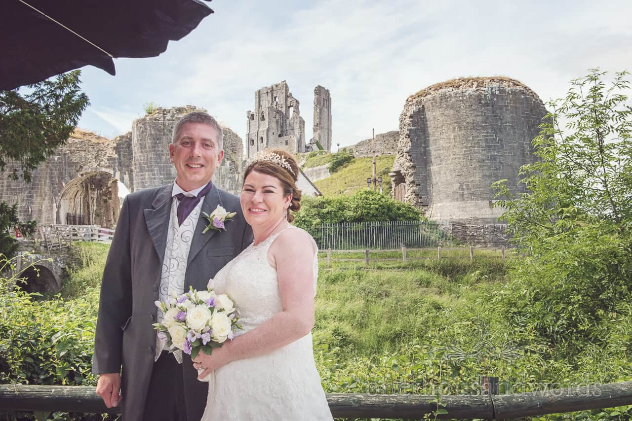 Bride and groom next to Corfe Castle, Dorset