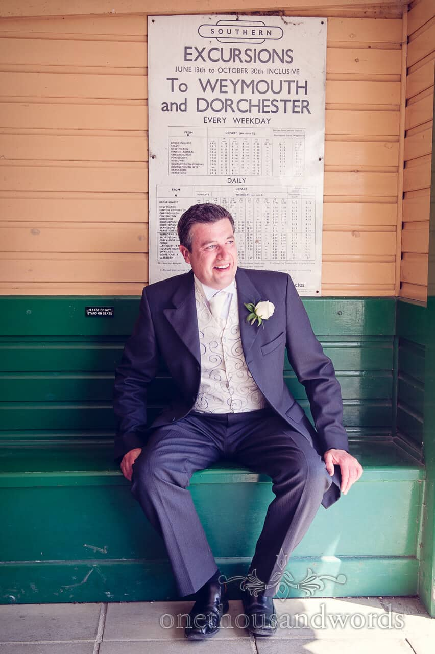 Wedding guest in Steam train station waiting room