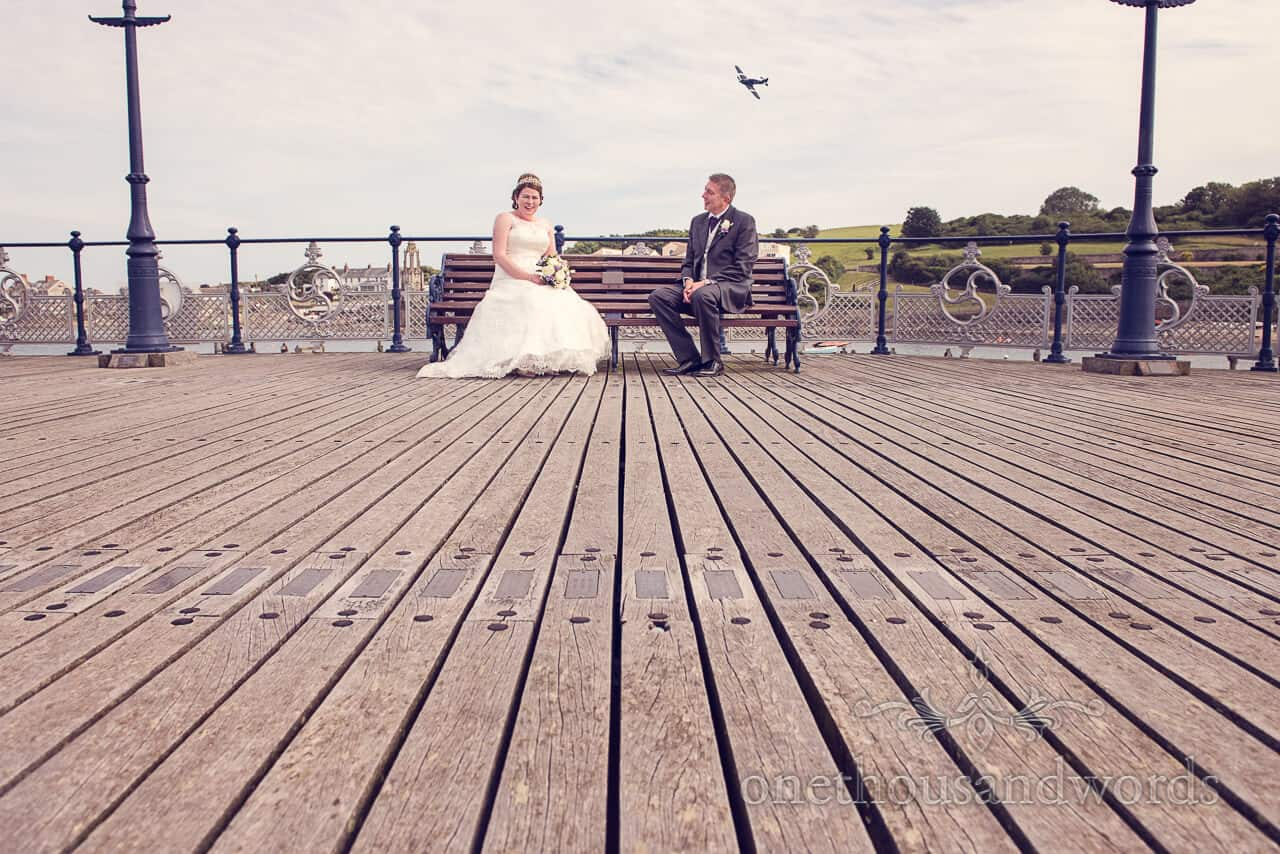 bride and groom on victorian pier with Hawker Hurricane