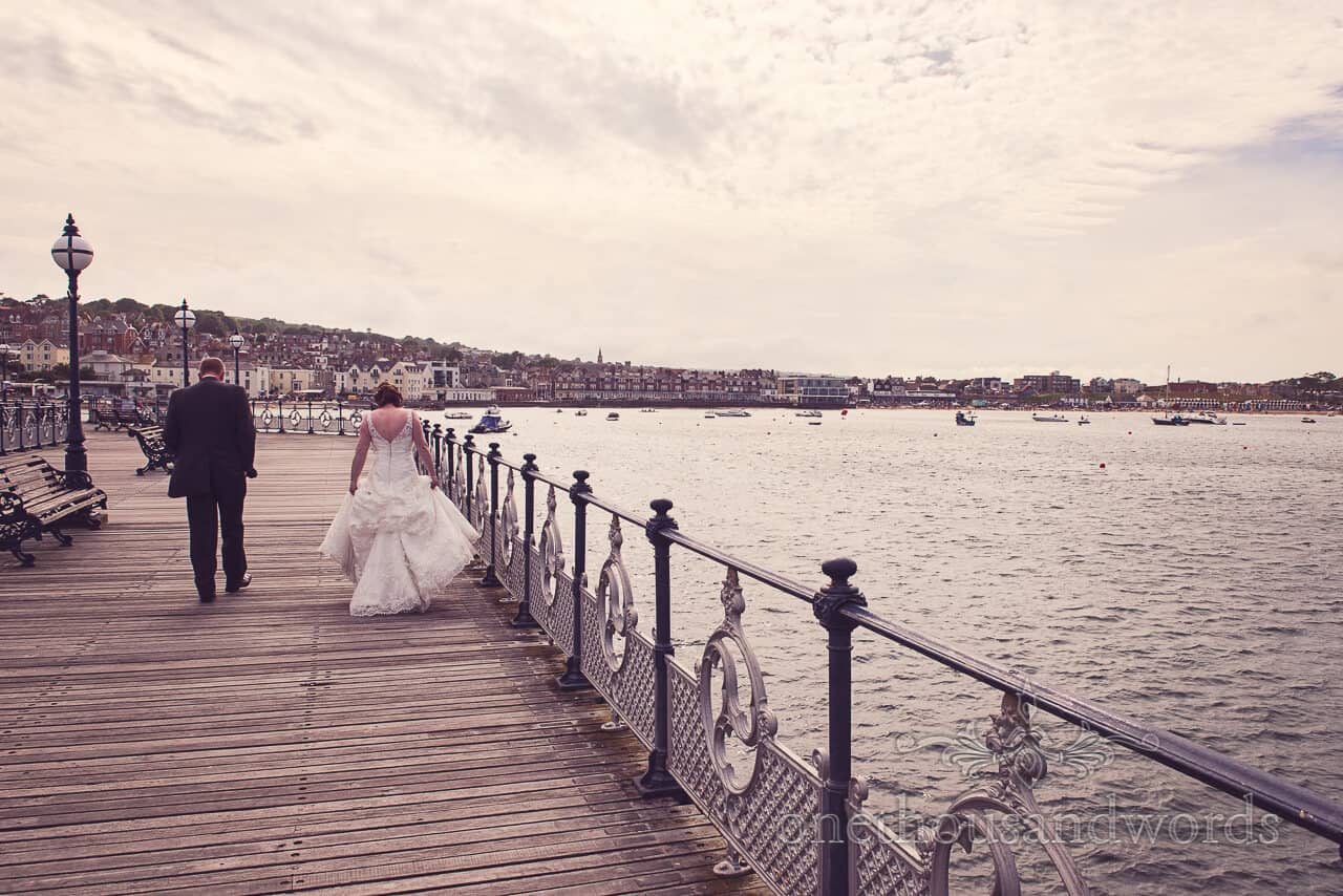 bride and groom on Swanage victorian pier