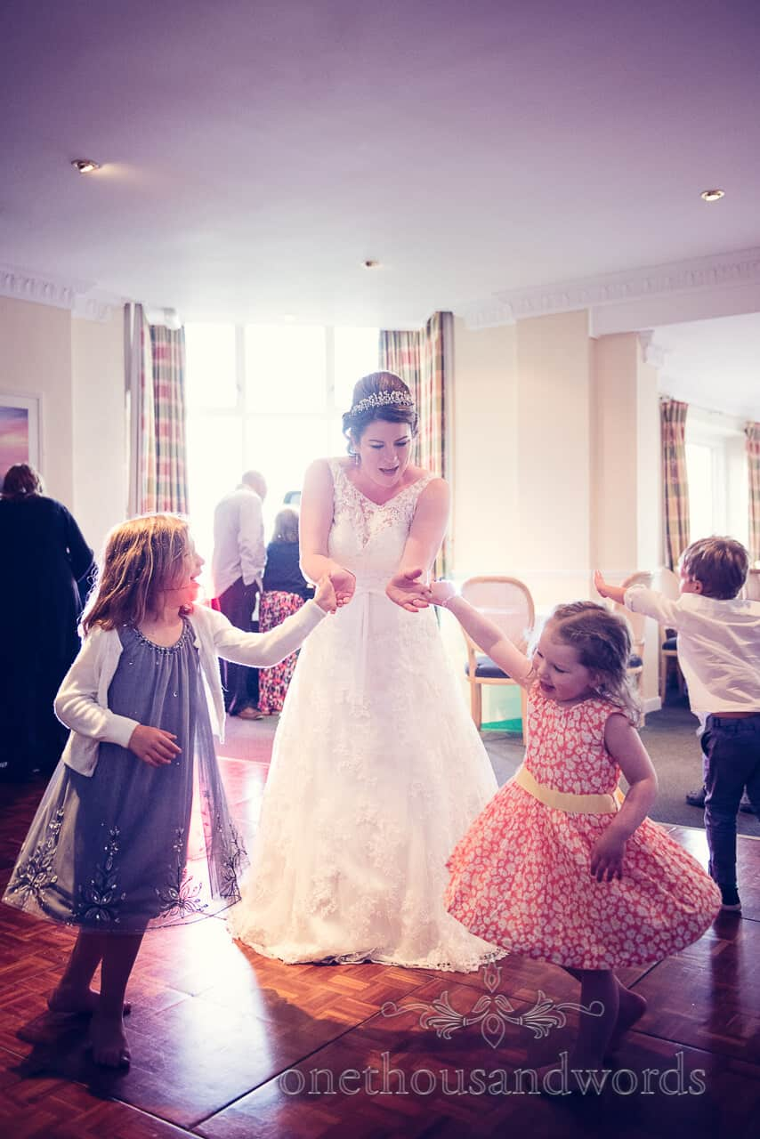 Bride dancing with children at Grand Hotel Swanage wedding