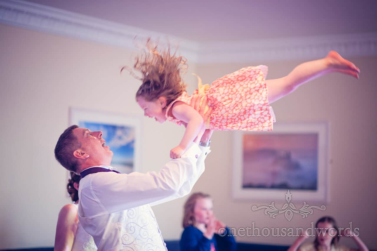 Groom dancing with daughter at Grand Hotel Swanage wedding