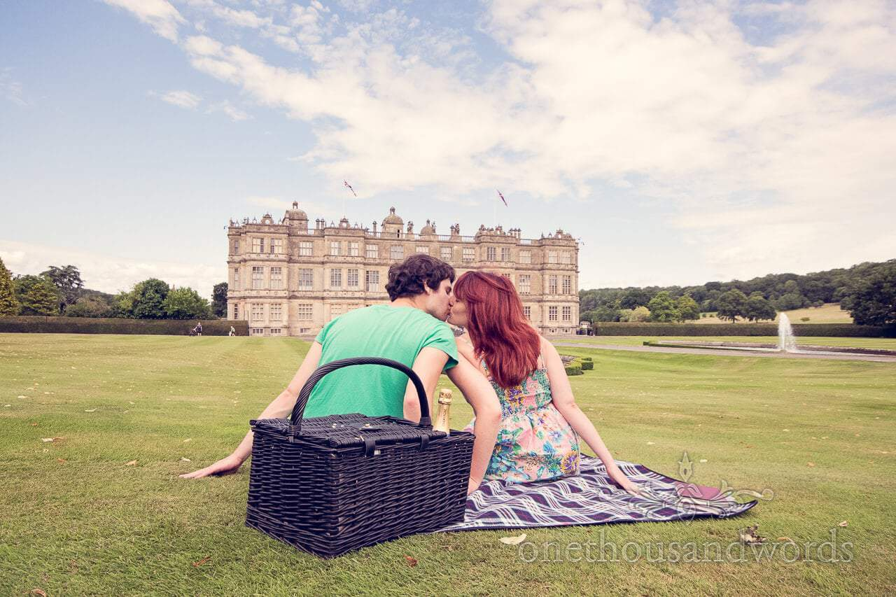 Longleat engagement photographs couple kissing infront of Longleat House