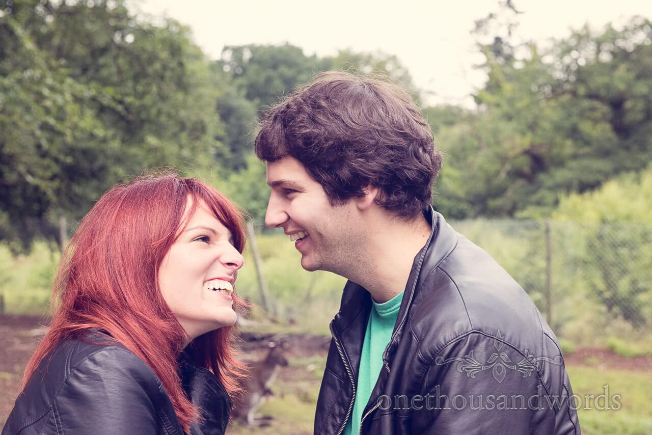 wedding couple laughing at engagment shoot