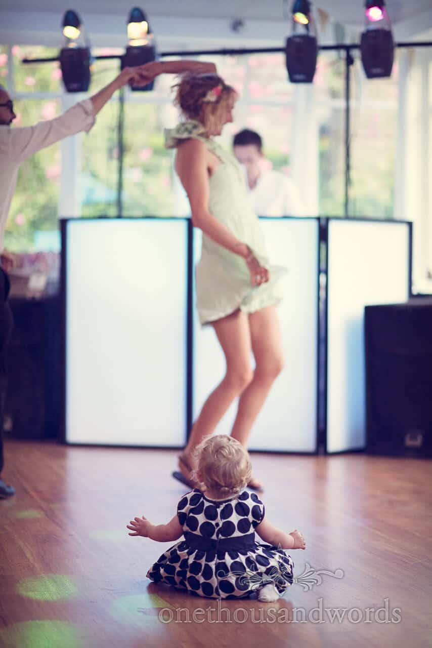 Baby watches wedding guests dance at Purbeck Hotel