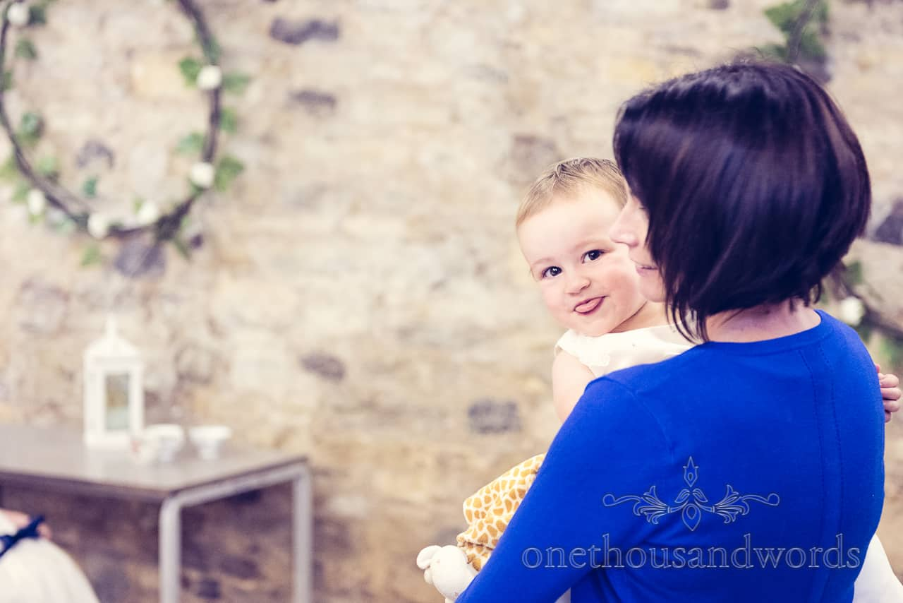 Baby Wedding Guest Sticking Tongue Out at Camera