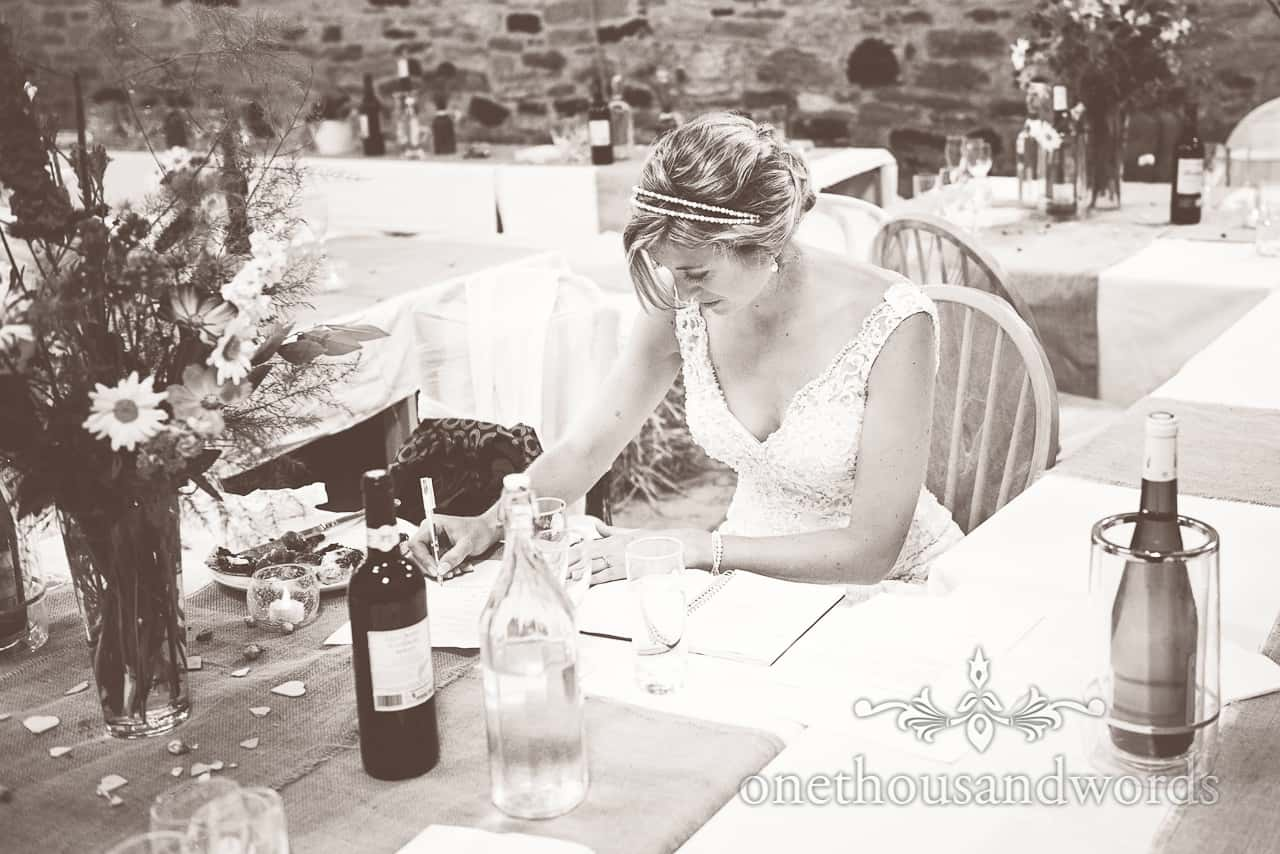 Black & White Wedding Photo of Bride Writing Speech