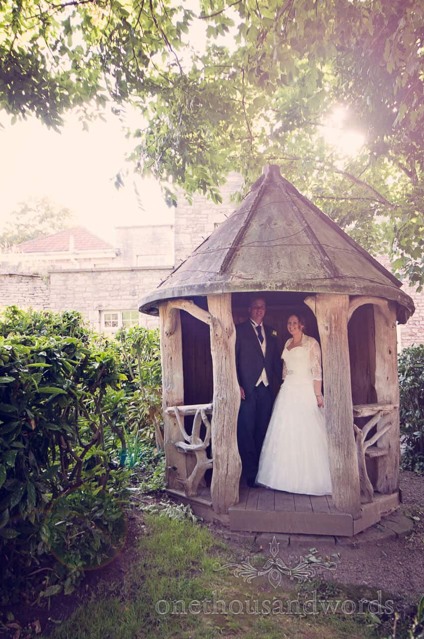 Bride and groom in lovely wooden summerhouse